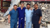 Image from BBC: David Nott with others undertaking medical work in war zone